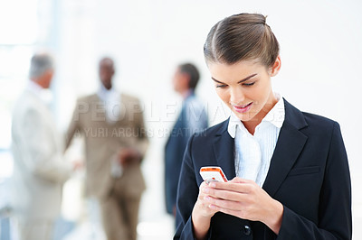 Buy stock photo Happy business woman messaging on her mobile phone