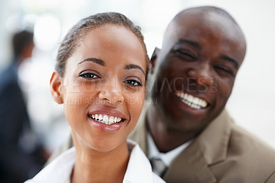 Buy stock photo Image of an African American business man and woman smiling together
