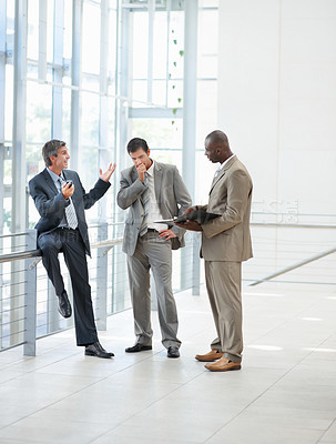 Buy stock photo Portrait of business men standing at the hallway with files and folders