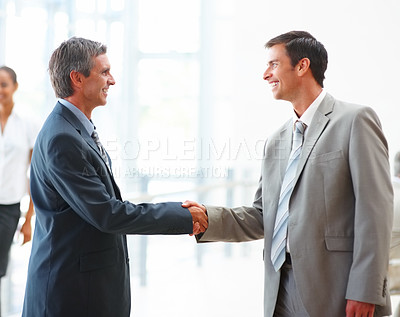 Buy stock photo Portrait of two happy business colleagues greeting eachother