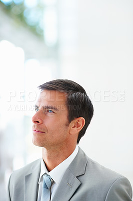 Buy stock photo Portrait of a happy young business man day dreaming