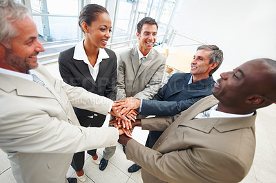 Buy stock photo Group of successful business people with their hands joined together