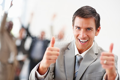 Buy stock photo Cheerful young business man with his thumbs up