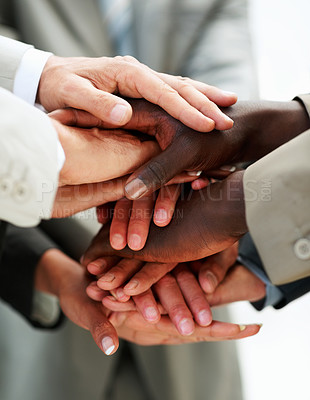 Buy stock photo Closeup image of hands of businesspeople on top of each other as symbol of their partnership