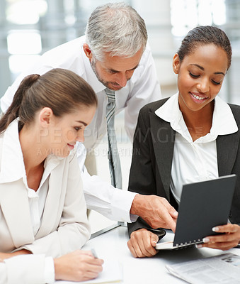 Buy stock photo A successful group of business people sitting in the office and working