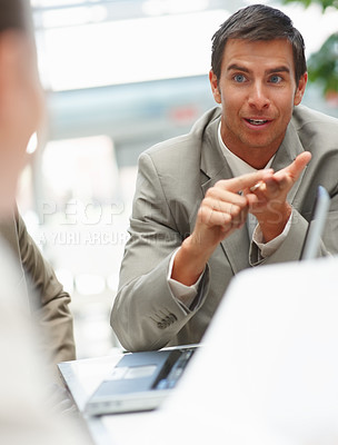 Buy stock photo Successful young man at a business meeting