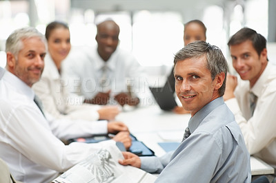 Buy stock photo Image of a professional group of business people at a meeting