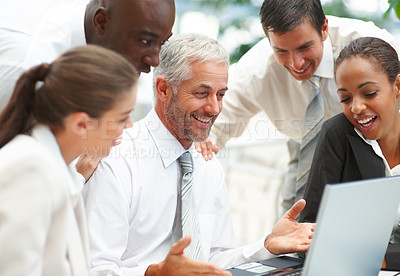 Buy stock photo Senior business woman working with a team of colleagues