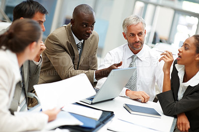 Buy stock photo Creative business team busy at a meeting