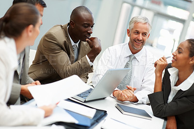 Buy stock photo Portrait of creative business people busy in a conversation at the meeting