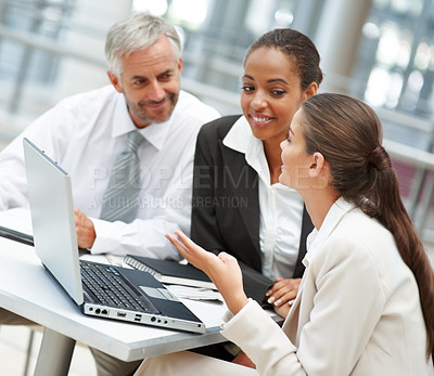 Buy stock photo Happy business colleagues working on a laptop