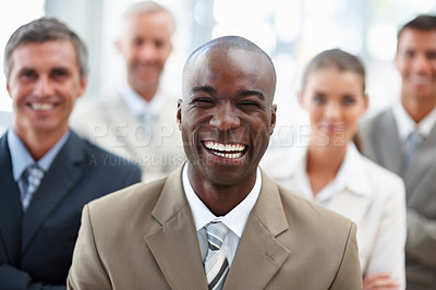 Buy stock photo Portrait of an African American business man with colleagues at the back
