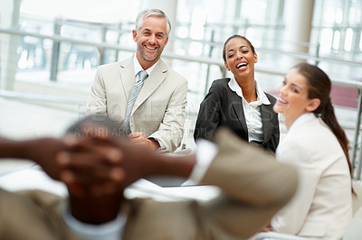 Buy stock photo Happy group of business colleagues having fun while working