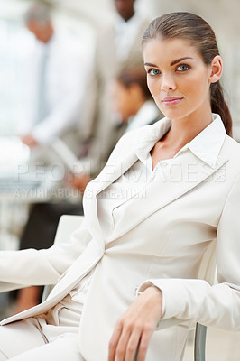 Buy stock photo Portrait of an elegant business woman sitting in the office
