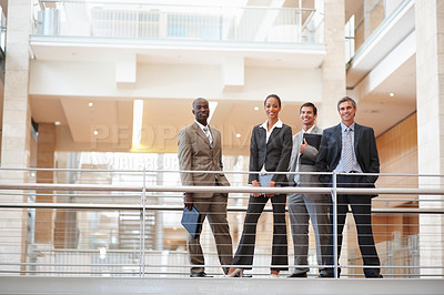 Buy stock photo Portrait of business people standing by a railing