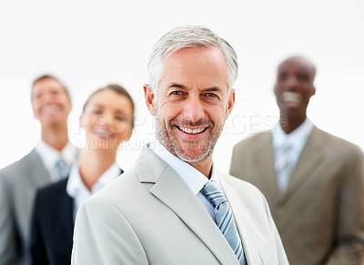 Buy stock photo Happy boss with his business team at the background