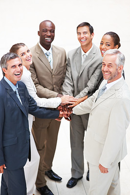 Buy stock photo Portrait of a group of business people with their hands joined together