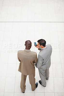 Buy stock photo Rear view image of two business men standing together