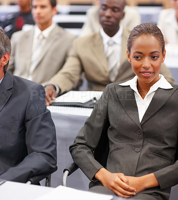 Buy stock photo Portrait of a young business woman at a business conference