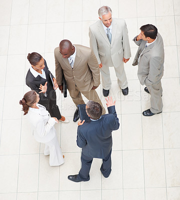 Buy stock photo Upward view of a team of business people standing together