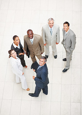 Buy stock photo Confident group of business people looking above and smiling