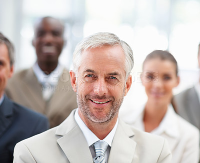 Buy stock photo Portrait of a happy old business man with team at the back