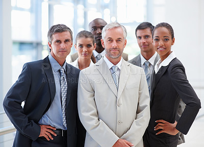 Buy stock photo Portrait of a confident proud business group standing together
