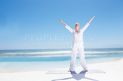 Buy stock photo Full length portrait of an old mature lady performing yoga at the beach