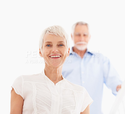 Buy stock photo Portrait of a happy old woman with her husband at the back