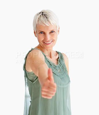 Buy stock photo Portrait of a happy old woman showing a thumbs up on white