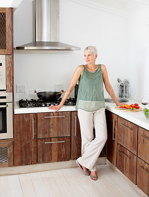 Buy stock photo Portrait of an old woman standing in the kitchen