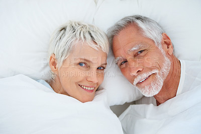 Buy stock photo Cute senior couple enjoying themselves in bed