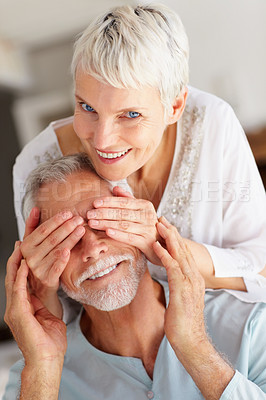 Buy stock photo Portrait of a senior old woman covering her husband's eyes to surprise him