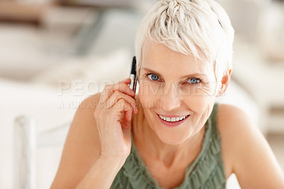 Buy stock photo Cute mature conversating over the cellphone