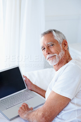 Buy stock photo Portrait of senior retired happy man with a laptop