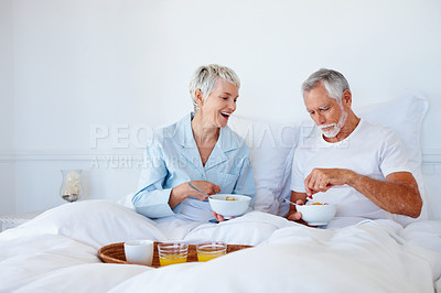 Buy stock photo Aged couple enjoying a healthy breakfast in bed