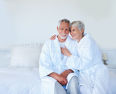 Buy stock photo An attractive mature couple enjoying themselves in the bed room