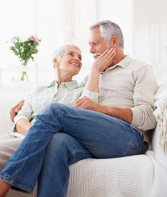 Buy stock photo Romantic aged retired couple peacefully sitting together