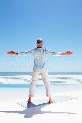 Buy stock photo Rear view of a senior old man with hands stretched, standing on the beach