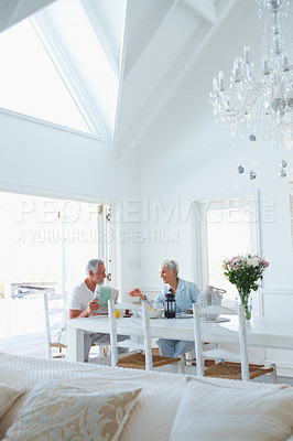 Buy stock photo A healthy retired old couple having breakfast in the morning