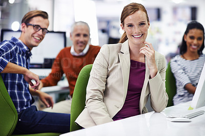 Buy stock photo A portrait of happy coworkers sitting in their office