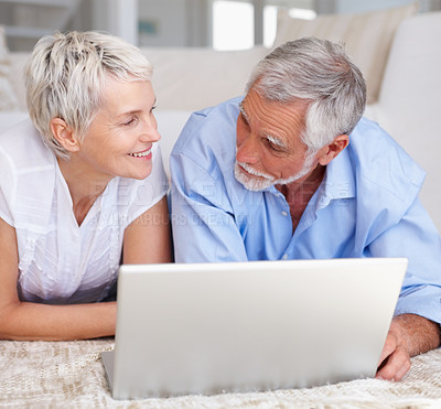 Buy stock photo Portrait of a senior aged couple browsing on a laptop