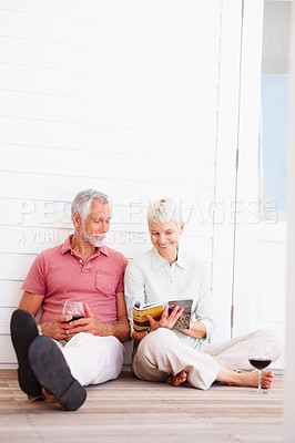 Buy stock photo Happy mature couple having a good time at home