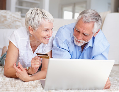 Buy stock photo Portrait of an old couple using their credit card to shop from the net