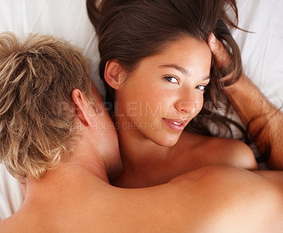 Buy stock photo Happy young couple indulged in sexual intercourse on the bed