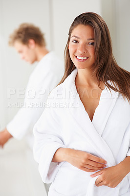 Buy stock photo Cute woman in a bath robe with boyfriend at the back