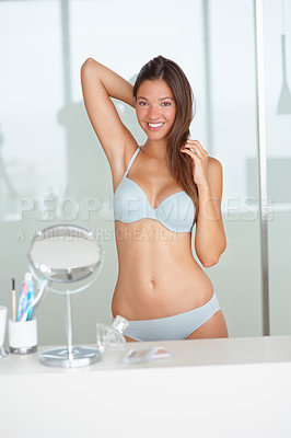 Buy stock photo Sexy young female in bra and panty at her bathroom