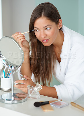 Buy stock photo Happy young woman applying her makeup and preparing herself