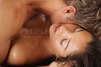 Buy stock photo Closeup of a passionate newlyweds during foreplay on the bed