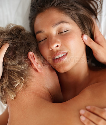 Buy stock photo Closeup of a young couple having sexual intercourse on the bed